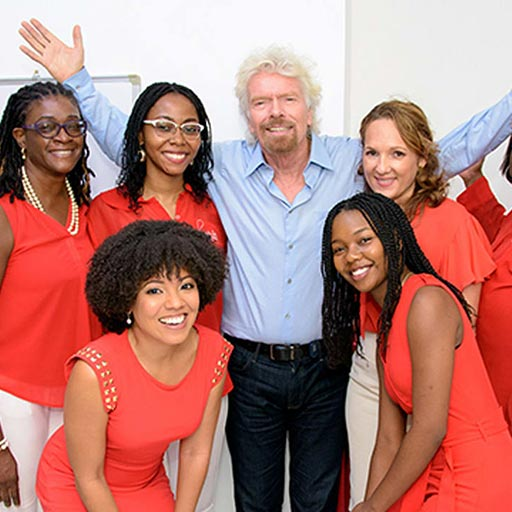 Richard Branson with employees at The Branson Centre of Entrepreneurship Caribbean